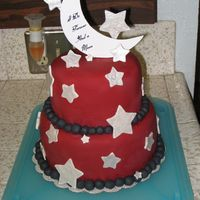 Star And Moon Wedding Cake This was a cake made for my cousin's wedding. They wanted the cake to match their wedding colors (black & burgandy red), the...