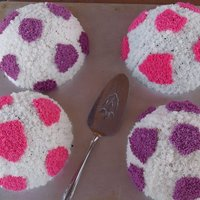 Soccer Ball Cakes These are soccer ball cakes for my daughter's birthday. They are only halves because we had to transport them quite a distance.