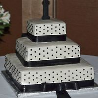 Black And White Cake  The bride wanted this cake to be elegant and chose not to have flowers on it, but there was a bouquet on the table next to the cake. There...