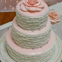Retro Looking Cake This bride wanted a fairly plain, but retro look. The beads around the layers are fondant rolled in shimmerdust. The rose on top is...