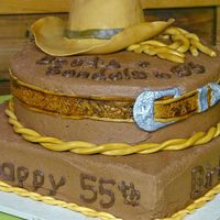 Western Cake  I made this cake for our square dance club's birthday. The hat, belt, buckle and rope are fondant. My goalwas to get the hat and belt...