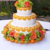 Closer_View.jpg the bride wanted oranges, green grapes, orange roses-the florist helped up decorate-there are also limes-her colors were bright orange and...
