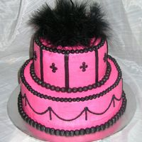 Pink And Black This cake was done for a woman turning 50. She wanted something girlie and she loves pink and black.