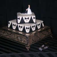 Black And White Tuxedo Groom's Cake Originally the cake was supposed to have chocolate covered strawberries on it.They decided last minute they didn't want the...