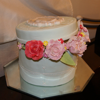 Hat Box Cake With Sugar Flowers This cake was made as a showpiece for a Chinese Auction. I wanted to make a cake that i haven't done before and wanted to try for a...