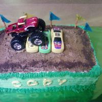 Monster Truck Rally  Made for a boy's monster truck themed birthday party! Cake was half yellow, half chocolate. Icing was buttercream, and I crushed some...