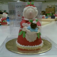Mrs Claus Mrs Claus made out of mini bell shaped fruit cake and lots of fondant. Fun class to do.