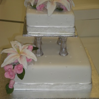 White Wedding Cake made in class. first large flowers, first wedding cake, first tiered cake.