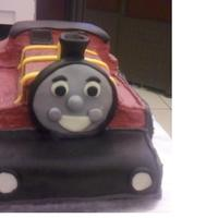 James The Train Customer cake. Half chocolate half yellow buttercream icing and modeling candy details. TFL!