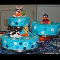 Baby Looney Tunes Shower Cake Shower cake I made for my sister's shower. Yellow cake with strawberry creme filling buttercream icing. The accents and characters are...