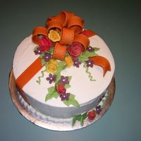 Fall Colors A birthday cake done with flowers in fall colors. The idea came from a wedding cake I did.(in the Square Wedding cakes gallery) Thanks for...