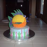 3D Fish Cake from Wilton yearbook 05 or 06? 8in round w/ball pan for fish. fondant eyes, lips and fins.