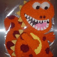 Orange Dinosaur From 2005 Wilton yearbook. 2 heart pans. Sugar cookie tail, scales, arms, feet and eyes.