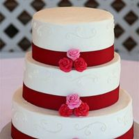 Wedding_Cake.jpg This is my first wedding cake. It's all buttercream frosting with red and pink gumpaste roses.