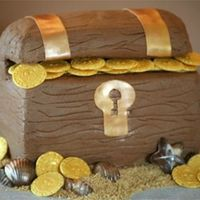 Treasure Chest I made this for a friends son's bday. His sister got the Belle cake. The chest is iced in buttercream with fondant accents. The coins...