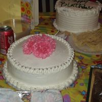 Dawn's Birthday Cake  Home made yellow cake. Real carnations. My house was so hot that the buttercream kept melting. I had such a hard time. I was sooooo upset...