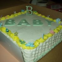 Nabcy & Paul's Baby Shower Cake 12x12x4 Plain yellow cake with bavarian cream filling, buttercrean iceing & fondant accents.