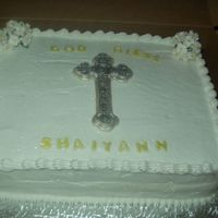 Shaiyann's Baptism   Two layer pound cake with 1/2 pineapple and 1/2 strawberry. Buttercream icing fondant cross and letters & gum paste flowers