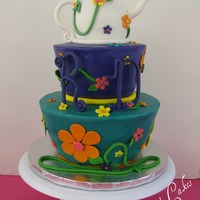 A Tea Party This cake was for my daughter's 10th birthday. It had cake disaster written all over it & then I did drop the purple tier, LOL! I...