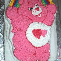 Pink Care Bear Birthday Cake  This was a last minute cake. I had very little notice. They wanted it to feed a lot of people. I made a 2 layer 9 X 13 sheet cake and made...