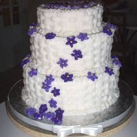 Dcp_0016.jpg   My very first wedding cake. It's a buttercream basketweave with violets. It's not perfect but I was thrilled how it turned.
