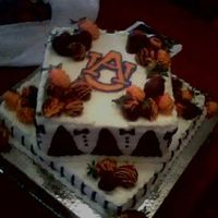 Au Square 2 Tier Grooms Cake Dark Chocolate Layers, Almond Buttercream, Fresh Strawberries dipped in milk and dark chocolate and orange candy melts... The AU logo is an...