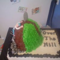 Over The Hill  First OTH cake for a friend. Buttercream frosting over chocolate hill and vanilla base. Fondant man (forgot to take out toothpicks before I...