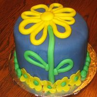 Yellow Flower This is a going away cake for a co-worker. I had completely different plans for the cake. Once I got it covered with the blue fondant, I...