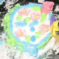 My Niece's First Decorated Cake My 9 year old niece decorated this. She used some of my flowers