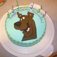 "Daughter's 7Th Birthday Chocolate cake with buttercream icing. Scooby Doo in colorflow. She loved the words. ""Rappy Rirthday Rarrannah!"""