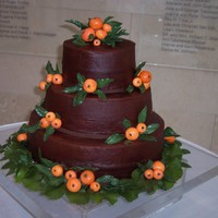 Clementine Oranges And Chocolate Fudge Cake The groom loves chocolate and orange together. The cake is chocolate fudge cake with an almond brickle bottom. I injected the baked cake...