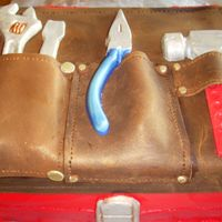 Tool Belt This cake was for a builder who loves his tool belt and tool box. The cake is Kahalua Fudge with an almond brickle crust and chocolate...