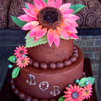 Persimmon Sunflowers All flowers, leaves, and decorations are a gumpaste/fondant mixture. The small sunflowers are made using a plunger. The large sunflower...