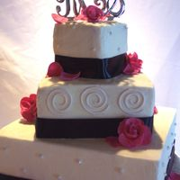 Hot Pink And Black Wedding Cake Hot pink and black accent this modern look. The cake is french vanilla with buttercream icing. The roses are made from gumpaste and the...
