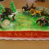 Narnia Birthday Cake Narnia cake in the fight scene with the stone table in the background.