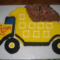 Dump Truck Chocolate chip cookie cake .... Chocolate chip cookie baked in an 11 X 15 pan and cut out by hand. This was my grandson's 3rd birthday...