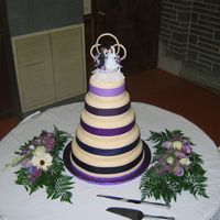 Wedding Cake W/ribbon Cake is yellow with strawberry filling, buttercream icing and then covered in ivory MMF. Ribbon is fabric. This is only the second wedding...