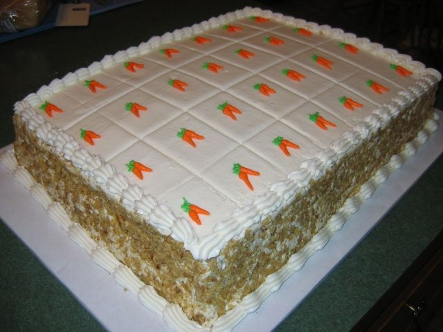 Carrot Cake Carrot Cake from scratch - two layers filled and decorated with homemade creamcheese icing. Cake scored for serving and each piece...