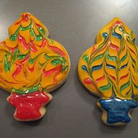 Ornaments These are no fail sugar cookies iced with antonia's royal icicng and then I used drops of Wiltons sparkle gel and swirled it with a...