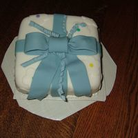 Course 3 Fondant Bow Cake I actually thought this turned out fairly well for my first time making it. I had trouble with the little curly strings and ran out of time...