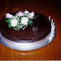 60Th Birthday Cake Once again, another mud cake covered in ganache with small fretwork chocolate lace around the entire top.Fresh pink rose on top. Thanks for...