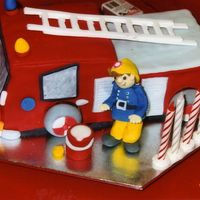 Fireman Sam Cake All white fondant icing. Took about 8 hours, but the kids loved it!