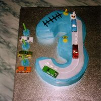 3Rd Birthday Cake Vanilla cake covered in blue buttercream, road is made from fondant, tic tacs, licorice, some little signs that belong to my sons, and some...