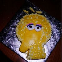 Big Bird Buttercream icing. fondant icing for beak, marshmallows for the eyes, and two chocolate smarties for eye centres.