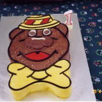 Humphrey B Bear My first ever cake ... done with buttercream, and licorice straps. The chocolate buttercream had coconut inside it. The nose is two mint...