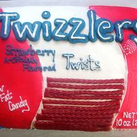 Twizzlers full sheet decorated to look like a bag of twizzlers, for a grooms cake. Red Velvet cake Strawberry filling.