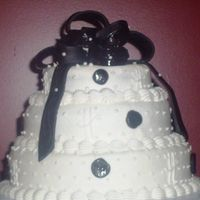 Black And White With Bow 3 tier red velvet with cream cheese filling. Black MMF bow and dots.