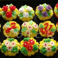 Posy Cupcakes Filled with blackberry. Flowers are from sugarpaste. Buttercream collored in yellow