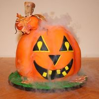 Smokin Carved Pumpkin Fondant Smokin' Carved Pumpkin Cake complete with dry ice to make it really look like a Jack o'lantern lit up and smokin.