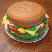 "Cheeseburger Cake  Three-layer, 10"" round cakes with fondant ""cheese,"" ""pickles,"" and ""sesame seeds"" and everything else..."